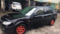 Cần bán Mazda 323 2003, màu đen, số sàn