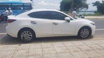 Cần bán Mazda 3 đời 2018, màu trắng, xe đăng kí 7/2018, odo 27000km