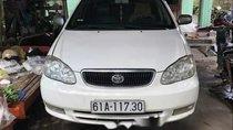 Gia đình bán Toyota Corolla altis sản xuất năm 2002, màu trắng
