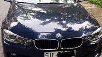 Bán BMW 320i sản xuất 2015, màu xanh đen, đi 36.000km, chính chủ bán