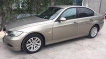 Gia đình cần bán xe Bmw 320i 2008, số tự động, màu vàng cát