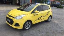 Bán ô tô Hyundai Grand i10 2015, màu vàng, xe đẹp, gầm bệ chắc chắn đã nên đồ chơi