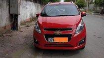 Gia đình cần bán Spark 2015 số tự động, màu đỏ, xe đi ít mới hơn 23000 km