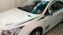 Bán xe Chevrolet Cruze 1.6 LS đời 2012, màu trắng, đã đi gần 12.000km