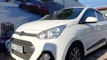 Cần bán Hyundai Grand i10 AT 2015, màu trắng