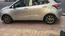 Chính chủ bán ô tô Hyundai Grand i10 2014, màu bạc
