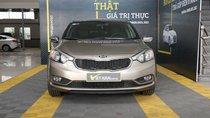Bán Kia K3 1.6MT màu vàng cát, số sàn, sản xuất 2015, biển Bình Dương đi 58000km