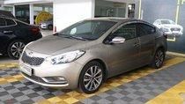 Bán Kia K3 1.6MT năm sản xuất 2015, màu vàng, 438tr