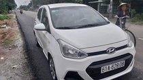 Bán xe Hyundai Grand i10 năm sản xuất 2014, màu trắng, nhập khẩu số sàn