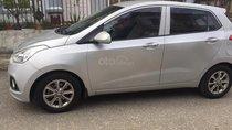 Cần bán xe Hyundai Grand i10 MT năm sản xuất 2015, màu bạc, có bảo hành