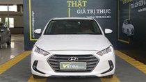 Cần bán Hyundai Elantra GLS 1.6 AT đời 2016, màu trắng, 566 triệu