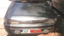 Bán xe Toyota Corolla sản xuất 1994, màu xám, xe nhập