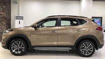 Cần bán xe Hyundai Tucson sản xuất 2019, màu vàng