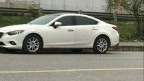 Cần bán gấp Mazda 6 đời 2014, màu trắng chính chủ, 63.9 triệu