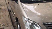 Gia đình cần bán Toyota Innova 2013, số sàn, màu vàng cát