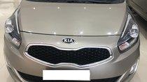 Cần bán xe Kia Rondo 2.0 GAT 2016, màu vàng