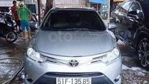 Bán lại xe Toyota Vios E đời 2015, màu bạc, số sàn, giá tốt