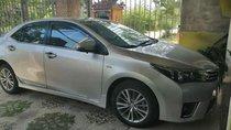 Bán Toyota Corolla altis đời 2015, màu bạc, không đậm đúng thủy kích