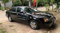 Cần bán lại xe cũ Daewoo Magnus năm 2004, màu đen