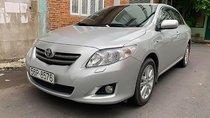 Cần bán gấp Toyota Corolla đời 2010, màu bạc, xe nhập