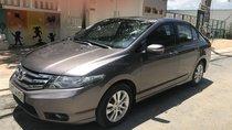 Cần bán Honda City đời 2014, màu nâu, gia đình sử dụng điều kiện còn rất tốt