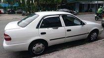 Cần bán xe Toyota Corolla 1999, màu trắng, xe mới đăng kiểm, gầm máy còn rất ok