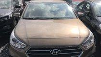 Bán Hyundai Accent số tự động, màu vàng cát