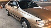 Cần bán Toyota Corona sản xuất năm 1992, màu vàng, nhập khẩu