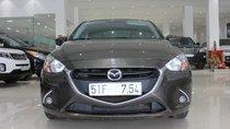 Cần bán Mazda 2 1.5AT Sedan đời 2016, màu nâu, biển số SG