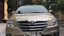 Cần bán xe Toyota Innova E 2015, màu ghi vàng, giá 515tr