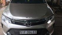 Kẹt tiền bán Toyota Camry 2.5Q đời 2016, màu vàng cát