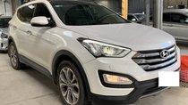 Hãng bán Hyundai SantaFe 4WD 2.4AT, 2015 màu trắng, biển SG
