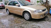 Bán Ford Laser Deluxe 1.6MT đời 2002, màu vàng, chính chủ