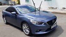 Bán Mazda 6 năm sản xuất 2014, màu xanh lam như mới