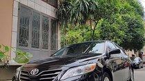 Gia đình bán Toyota Camry 2.5LE 2011, màu đen, nhập khẩu