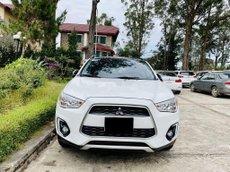 Cần bán xe Mitsubishi Outlander Sport sx 2014, màu trắng