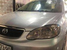 Cần bán Toyota Corolla đời 2002, màu bạc, 215tr