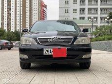 Cần bán lại xe Toyota Camry năm 2002, 265 triệu màu đen huyền bí