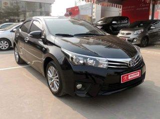 Cần bán xe Toyota Corolla Altis đời 2015, màu đen còn mới