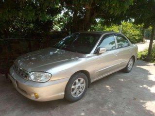 Cần bán Kia Spectra năm sản xuất 2005, màu vàng còn mới