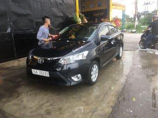 Cần bán lại xe Toyota Vios sản xuất 2014, màu đen