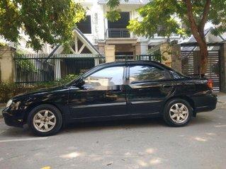 Cần bán xe Kia Spectra đời 2005, màu đen, xe nhập còn mới