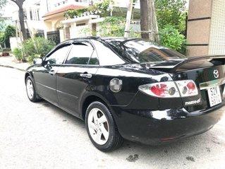 Cần bán Mazda 6 sản xuất năm 2003, màu đen, xe chính chủ sử dụng