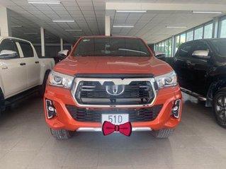 Cần bán xe Toyota Hilux 2.8G đời 2019, màu cam, số tự động, giá 869tr