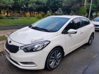 Cần bán Kia K3 đời 2016 Auto, bản full option, màu trắng, gia đình sử dụng mới 98%