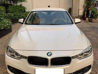 Bán BMW 320i LCI Sx 2016, xe màu đen, đi 21.000km, bao check hãng