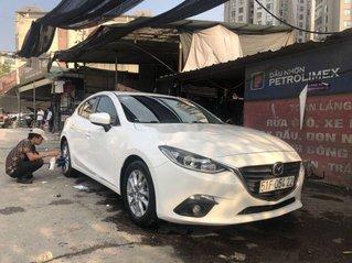 Cần bán xe Mazda 3 đời 2015, màu trắng, giá chỉ 485 triệu