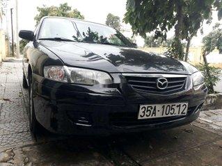 Cần bán lại xe Mazda 323 2004, màu đen, xe nhập còn mới