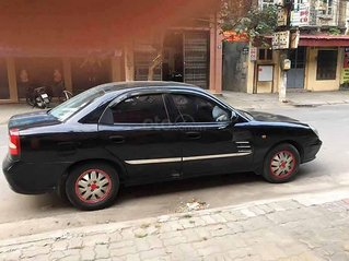 Bán gấp Daewoo Nubira năm sản xuất 2002, màu đen còn mới