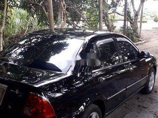 Cần bán Ford Laser năm 2002, màu đen, xe nhập